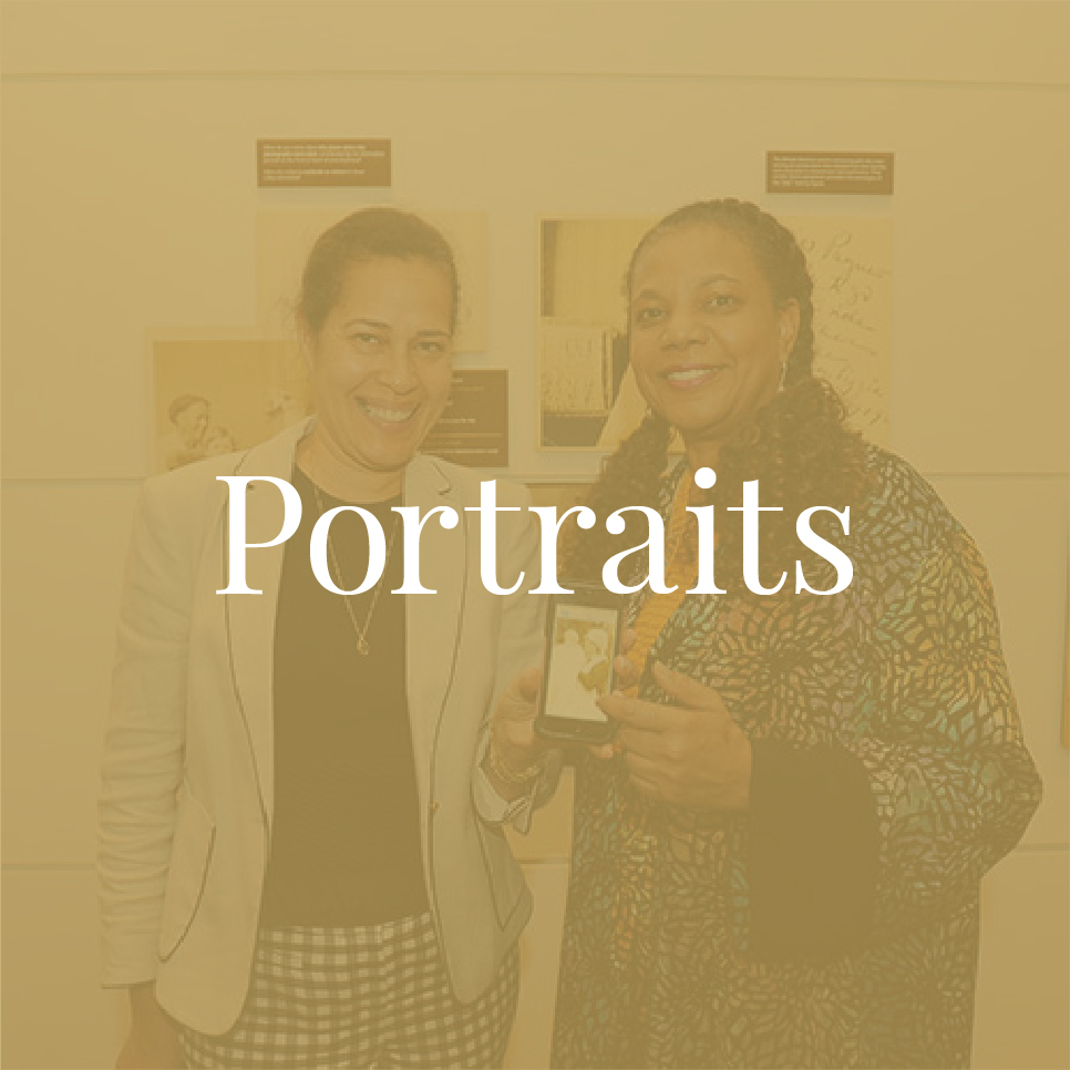 Photograph of woman with medium skin tone and woman with medium-dark skin tone holding photograph on phone